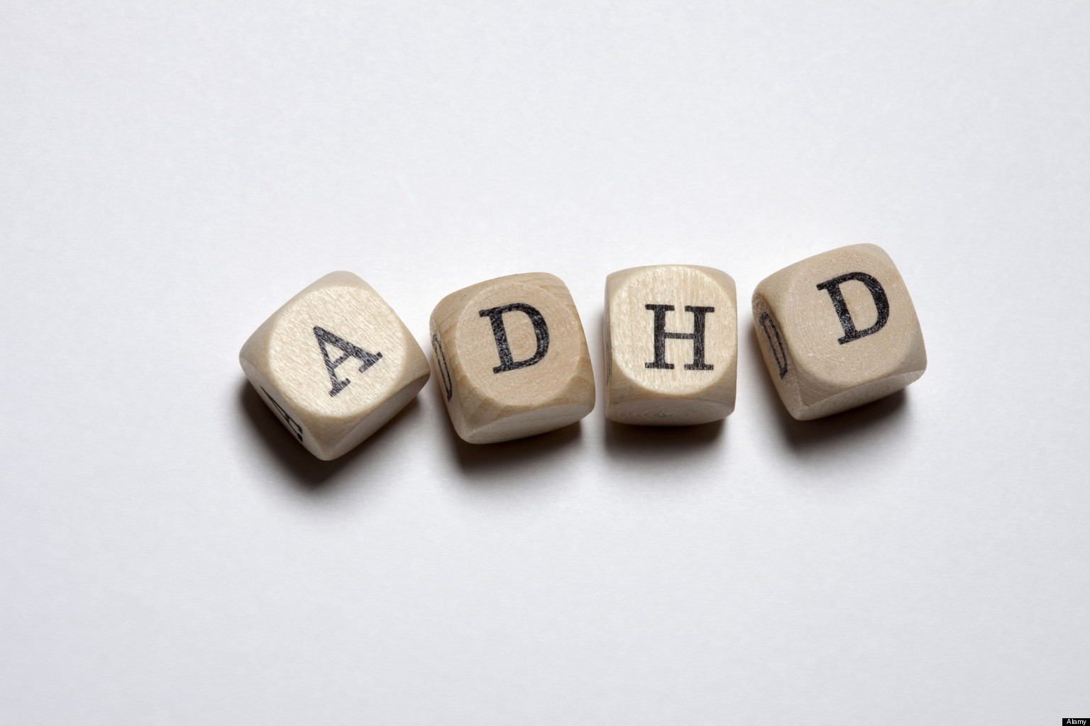 Lettered cubes arranged to spell the abbreviation ADHD. Image shot 2012. Exact date unknown.