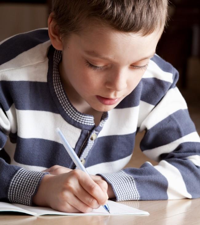 dictation-boy-writing